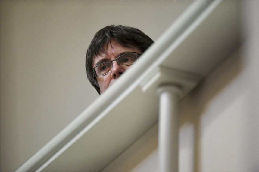 Former Catalan leader Carles Puigdemont attends Finnish Parliament session in Helsinki on March 22, 2018.