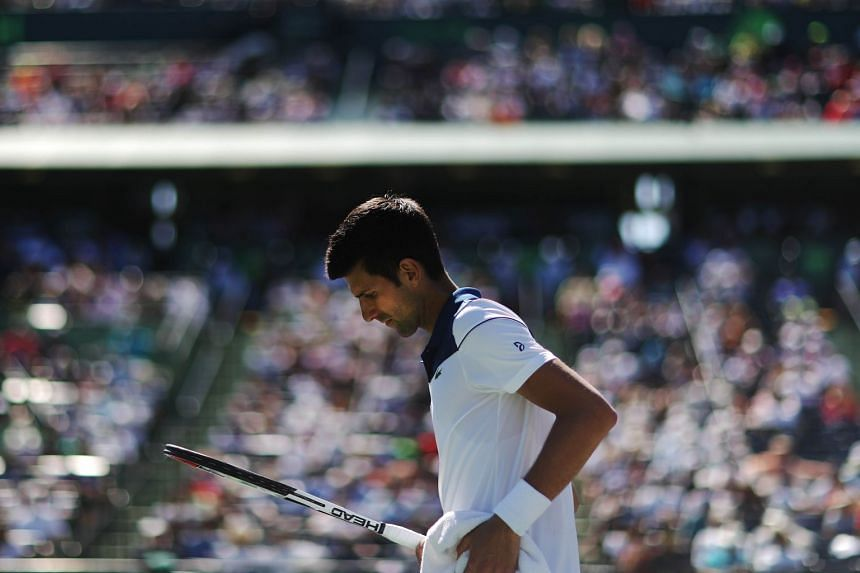 Novak Djokovic of Serbia reacts to a lost point against Benoit Paire (not pictured) of France during Day 5 of the Miami Open, on March 23, 2018 in Key Biscayne, Florida.