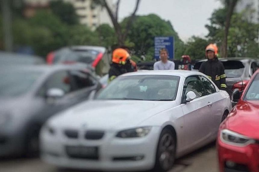 Singapore Civil Defence Force officers arriving at the location where a baby was trapped in a locked car in Holland Village.