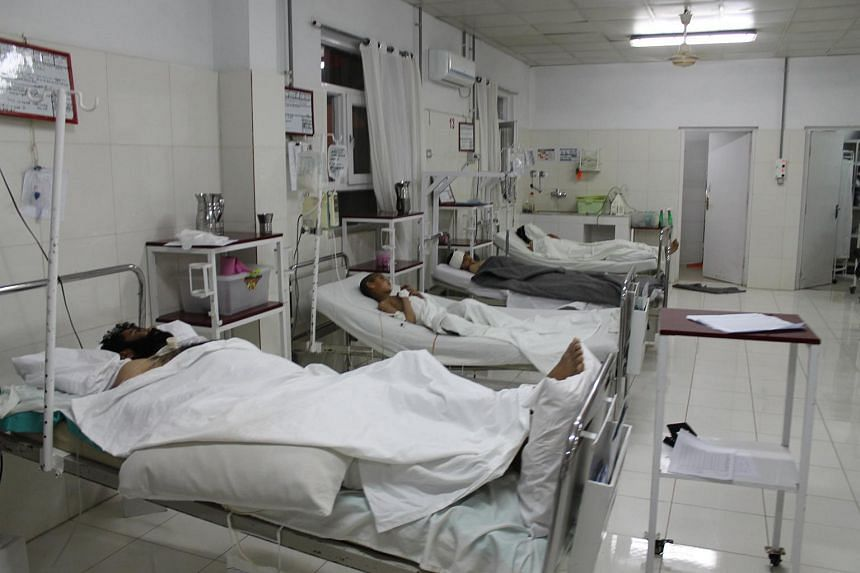 People receiving medical treatment at a hospital in Helmand, Afghanistan, after an explosion at the entrance gate of a sports stadium, on March 23.