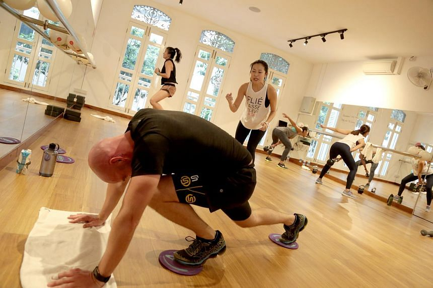 WeBarre Hiit circuit-style classes have a barre component, but include equipment such as kettlebells and resistance tubes for a more intense workout.