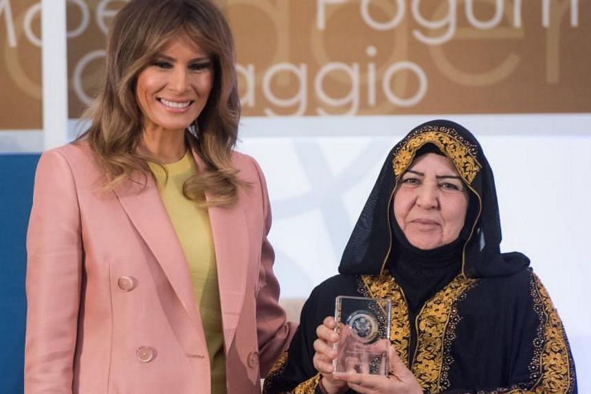 US First Lady Melania Trump presenting a 2018 International Women of Courage Award to Aliyah Khalaf Saleh during the Award Ceremony, on March 23, 2018.