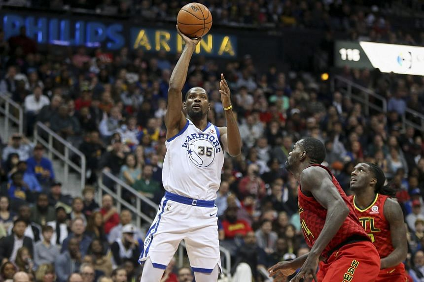 Golden State Warriors forward Kevin Durant (35) shoots the ball against the Atlanta Hawks in the second quarter at Philips Arena.