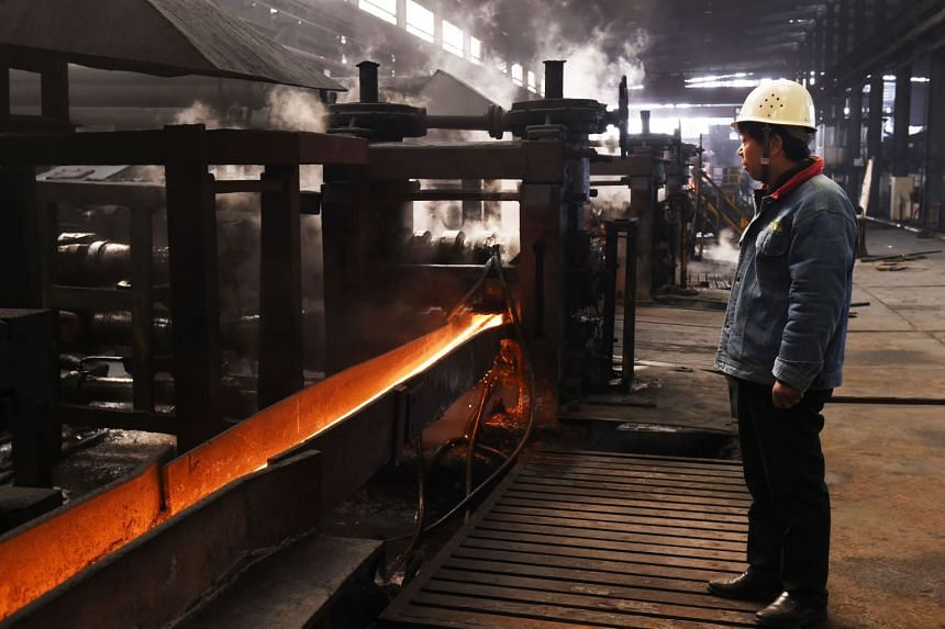 A worker stands in a steel workshop in Zouping, in China's eastern Shandong province on March 10, 2018.