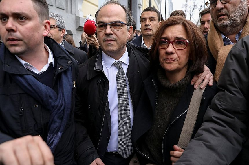 Catalan presidential candidate Jordi Turull leaving the Supreme Court in Madrid with his wife last Friday. He was among those held in custody.