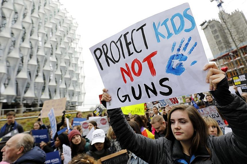 Protesters calling for greater gun control outside the US Embassy in London yesterday.