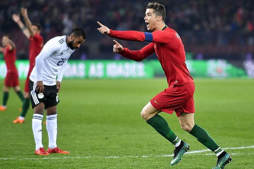 Portugal's Cristiano Ronaldo celebrating after scoring his second goal. The five-time World Player of the Year has scored one goal more than Salah this season - from five games fewer for Real Madrid.