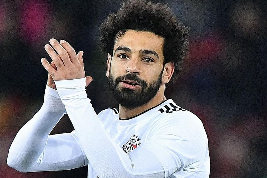 Egypt's Mohamed Salah applauding during the 2-1 friendly defeat by Portugal on Friday. The Liverpool forward is having an impressive debut season for his club, scoring 36 goals in all competitions.
