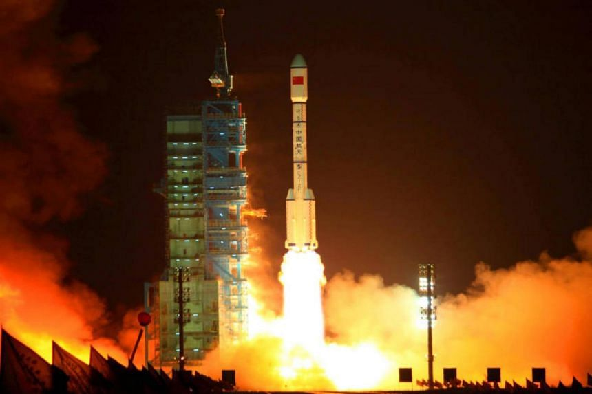 """China's Long March 2F rocket carrying the Tiangong-1 module, or """"heavenly palace"""", blasts off from the Jiuquan launch centre in Gansu province on Sept 29, 2011."""