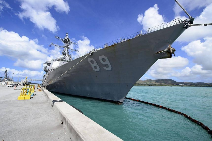 """The US navy destroyer Mustin docked in a port in Guam on March 14, 2018. In a """"freedom of navigation"""" operation held on March 23, the US Navy destroyer came within 12 nautical miles of an artificial island China has built in the South China Sea, prov"""