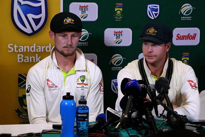 Australia's captain Steve Smith (right), with teammate Cameron Bancroft, speaking during a press conference in Cape Town as he admitted to ball-tampering during the third Test against South Africa on March 24, 2018.