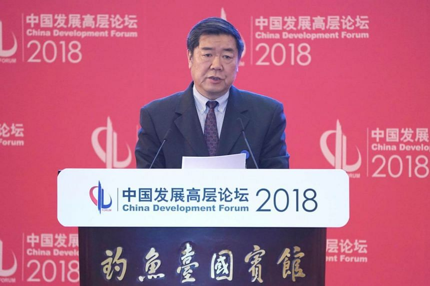 Chairman of China's National Development and Reform Commission, He Lifeng, speaks at the annual session of China Development Forum 2018 at the Diaoyutai State Guesthouse in Beijing on March 25, 2018.