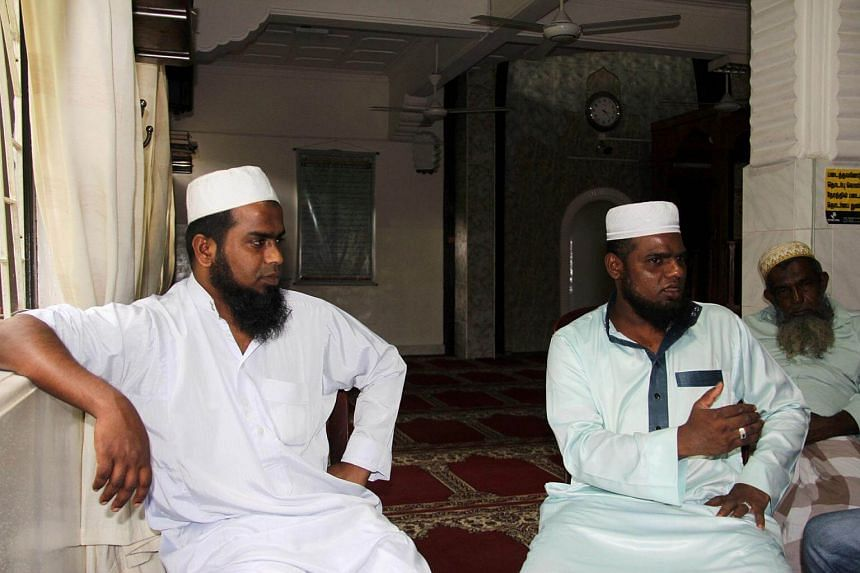 A.H. Ramees (left) and M.S.M Farwin, two Islamic clerics who claimed they were beaten by Sri Lankan police inside the Hijrapura Mosque during anti-Muslim riots.