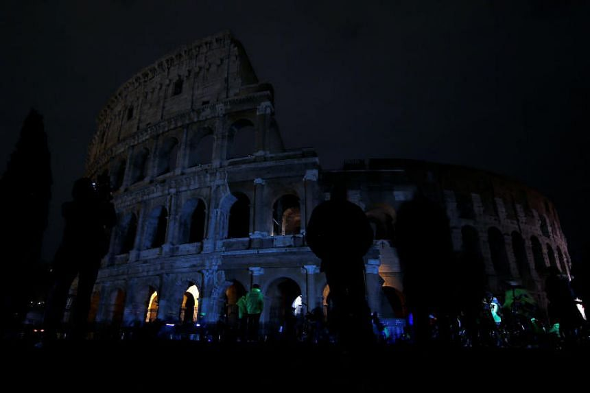 The ancient Colosseum is seen after the lights were switched off for Earth Hour in Rome, Italy, on March 24, 2018.