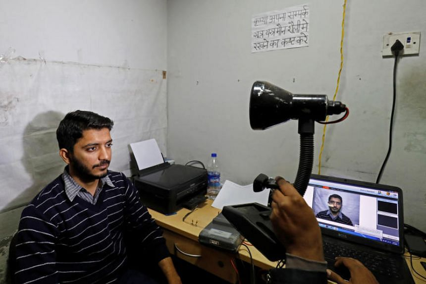 A man goes through the process of eye scanning for the Unique Identification (UID) database system, also known as Aadhaar, at a registration centre in New Delhi, India, on Jan 17, 2018.