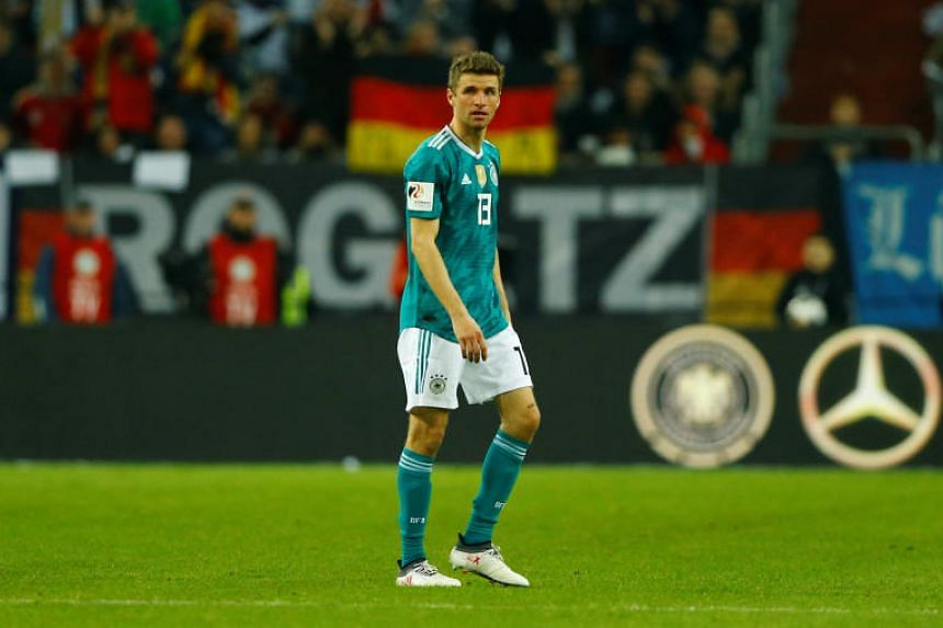 Germany's Thomas Mueller walks off the pitch as he is substituted.