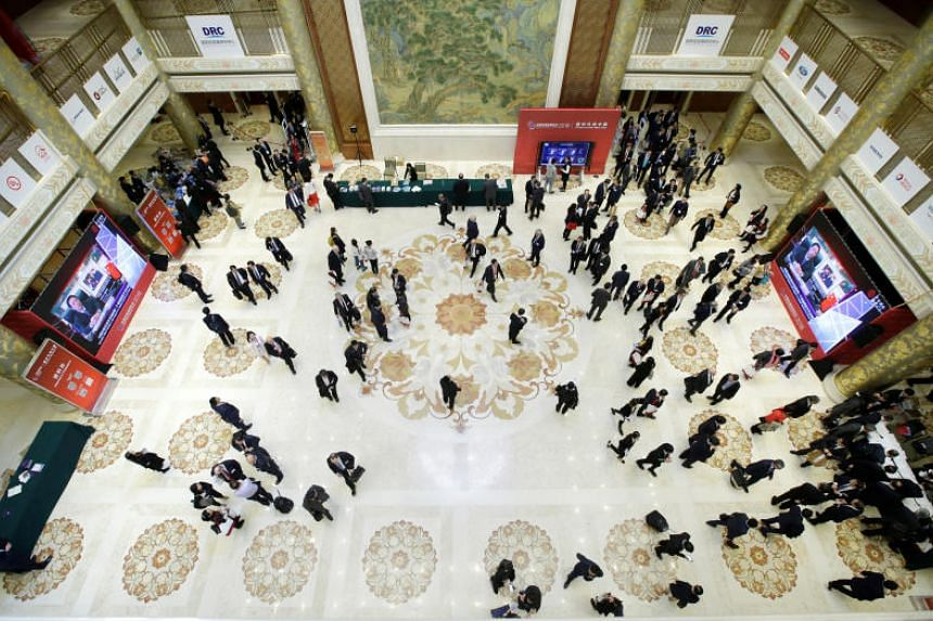 Participants rest in a lobby after a luncheon during the annual session of China Development Forum (CDF) 2018 at the Diaoyutai State Guesthouse in Beijing, China, on March 25, 2018.