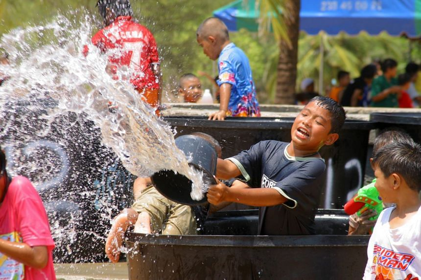 Take part in friendly water fights and street parties to celebrate Songkran, the Thai New Year.
