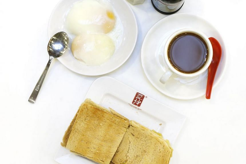 A traditional breakfast of kaya toast, coffee and soft-boiled eggs. PHOTO: BT FILE