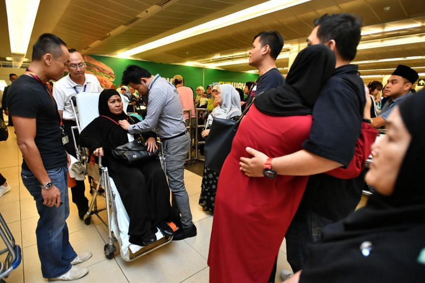 Relatives greeting pilgrims who were caught in the bus accident in Mecca, after they returned to Singapore on March 25, 2018.