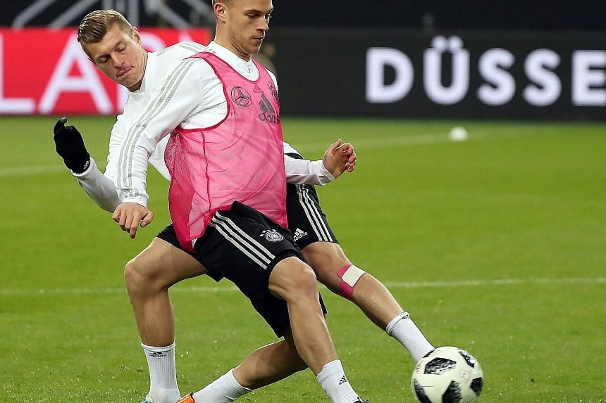 Toni Kroos attempting to put the shackles on team-mate Joshua Kimmich during their training session. Germany take on Brazil tomorrow in a repeat of their 2014 semi-final, when they gave Brazil a 7-1 thrashing.