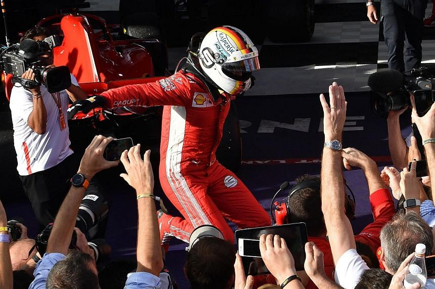 Ferrari's German driver Sebastian Vettel celebrating after winning the Formula One Australian Grand Prix in Melbourne yesterday. It was the four-time world champion's 48th win overall and third at Albert Park.