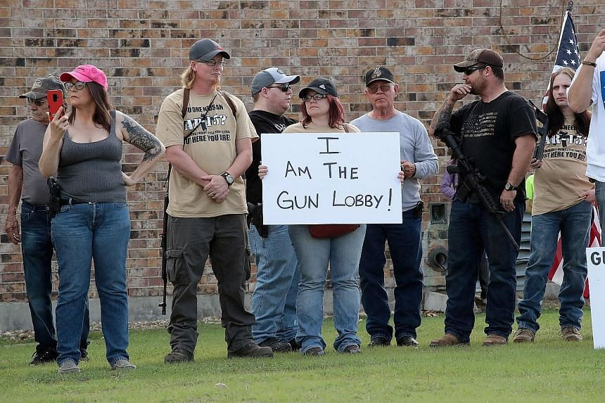 Demonstrators advocating the rights of gun owners staging a counter-protest near a March For Our Lives rally last Saturday in Killeen, Texas. The March For Our Lives events, organised by survivors of the Feb 14 Florida school shooting, call for legis
