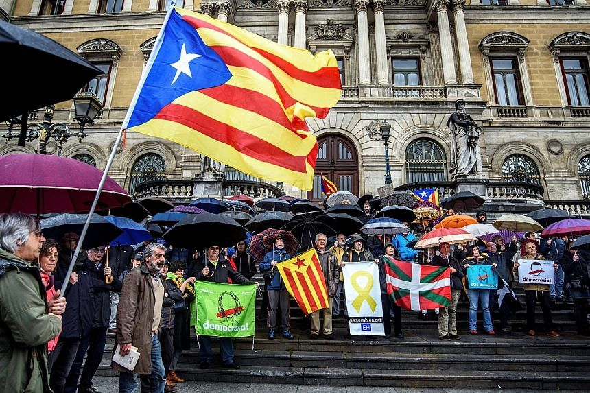 A protest in Bilbao, Spain, in support of imprisoned Catalan politicians yesterday. German police said they arrested Carles Puigdemont (below) on a European warrant issued by Spain.