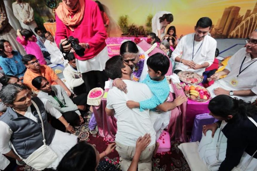 """Spiritual and humanitarian leader Sri Mata Amritanandamayi Devi, also known as Amma, has since hugged about 34 million people across the world, sometimes in marathon sessions that run for 20 hours, gaining the moniker of the """"Hugging Saint""""."""