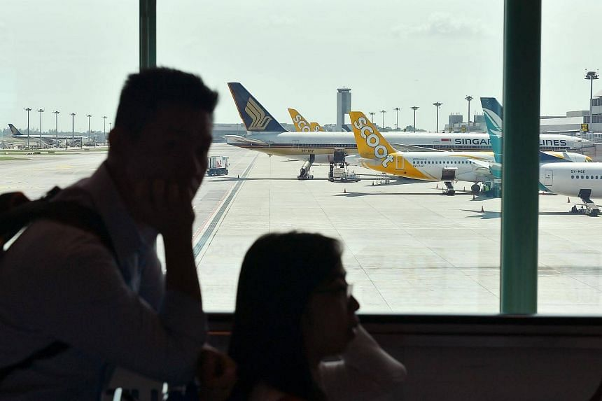 File photo showing aeroplanes of various airlines at Changi Airport Terminal 2 on Dec 18, 2017.