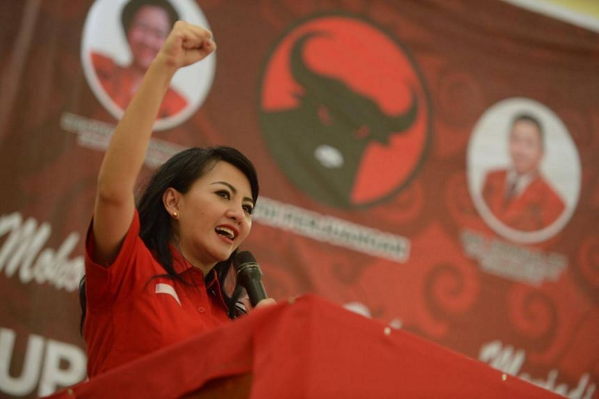Voters in Kalimantan will pick their next governor from a slate comprising the popular Dayak-Christian pairing of Karolin Margret Natasa (pictured) and Suryadman Gidot and their rivals, who include a duo of Muslim candidates.