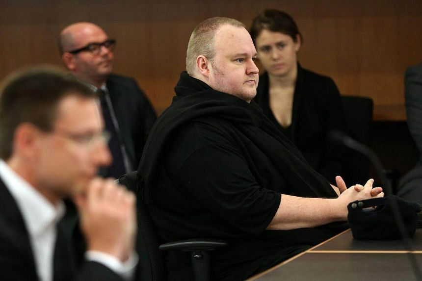 Internet mogul Kim Dotcom (front right) sitting in court to hear the judge's decision for his extradition case in Auckland, on Dec 23, 2015.