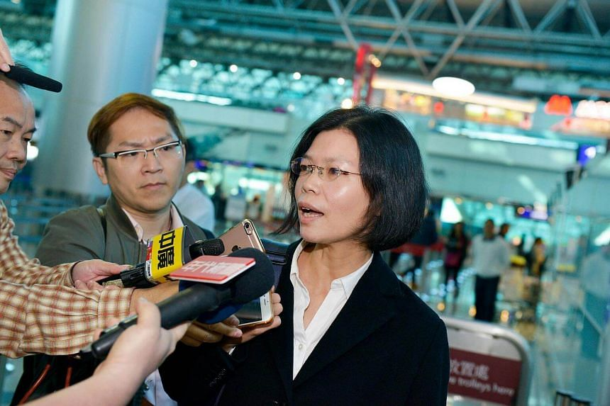 Lee Ching-Yu, wife of detained Taiwanese democracy activist Lee Ming-Cheh, speaks to the press at Taoyuan International Airport, near Taipei, prior to boarding her flight to Changsha, China on March 26, 2018.