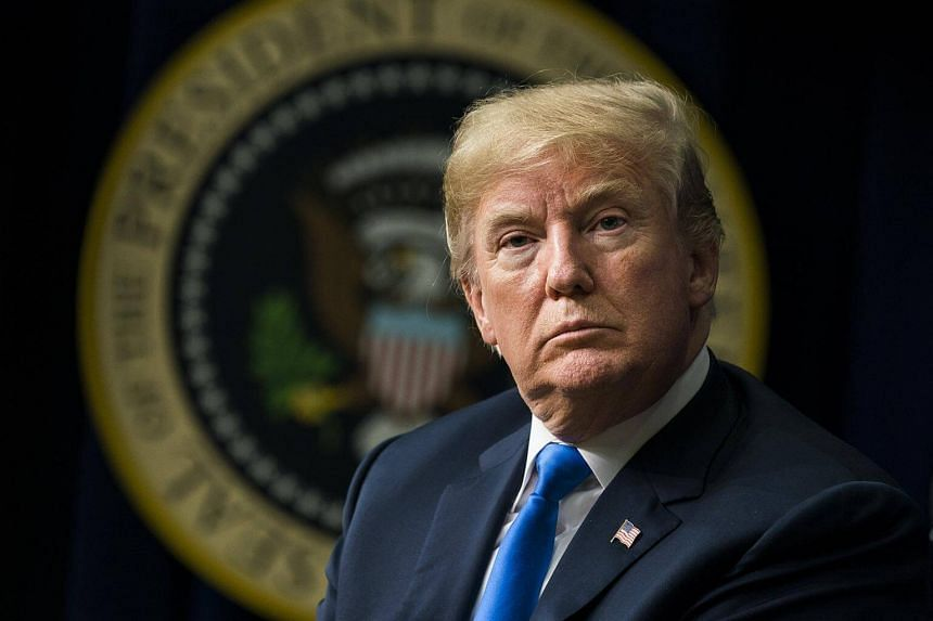 US President Donald Trump participates in a panel discussion at a summit in Washington, DC, on March 22, 2018