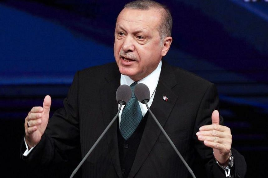 Turkey's President Recep Tayyip Erdogan delivers a speech during an award ceremony for high-school students in Ankara, on March 15, 2018.