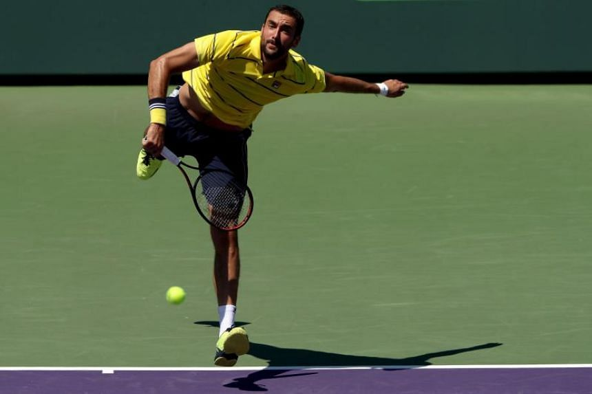 Marin Cilic of Croatia serves against Vasek Pospisil of Canada during the Miami Open Presented by Itau at Crandon Park Tennis Center on March 25, 2018 in Key Biscayne, Florida.