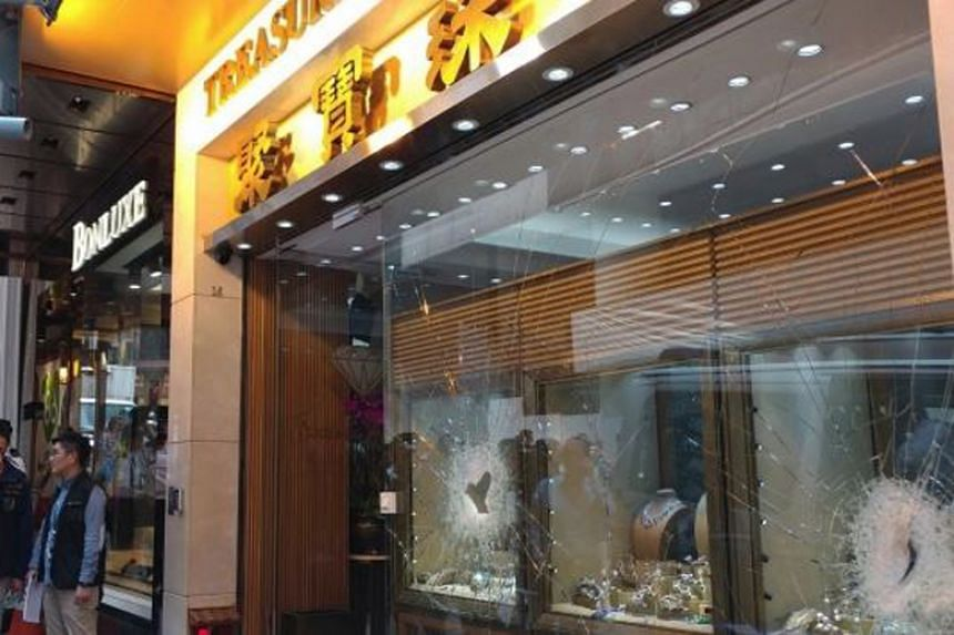 A gang of three masked men used a hammer to smash the display window of a Treasure Jewellery store on March 26, 2018.