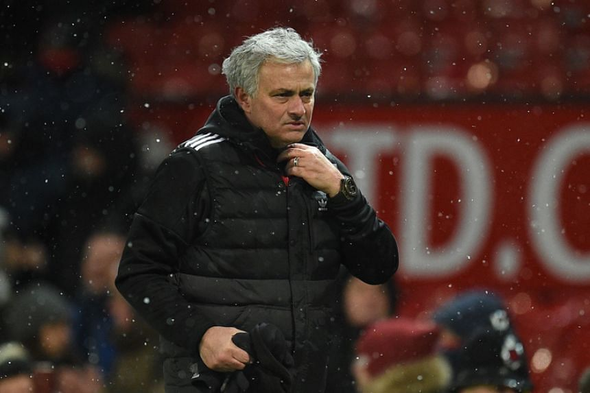 Manchester United manager Jose Mourinho reacts after the English FA Cup quarter-final football match between Manchester United and Brighton and Hove Albion at Old Trafford in Manchester on March 17, 2018.