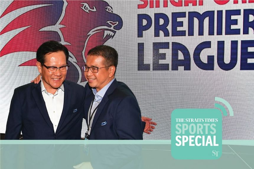 FAS president Lim Kia Tong (left) and vice-president Edwin Tong presenting the new league's logo