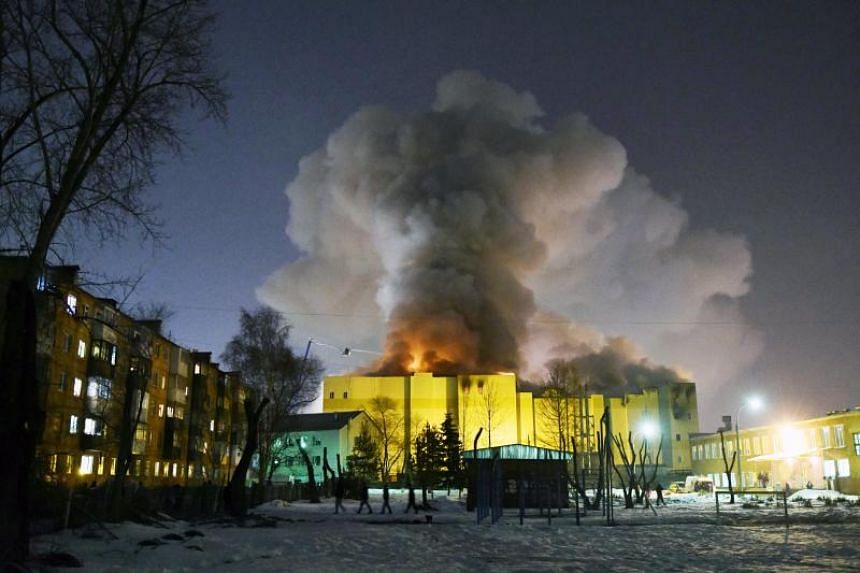 Smoke raises over a shopping center Zimnaya Vishnya in the West Siberian city of Kemerovo, Russia, on March 26, 2018.