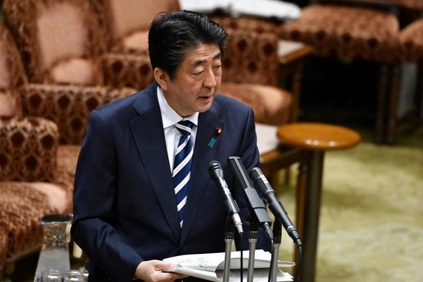 Japanese Prime Minister Shinzo Abe has said he wants to overhaul the broadcast law to put traditional television channels on equal footing with online media.