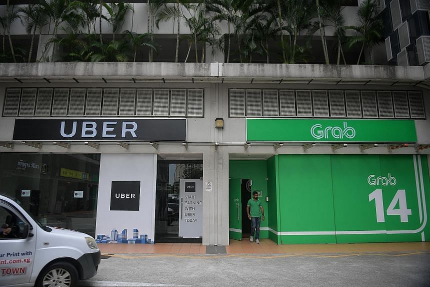 Grab and Uber offices at Midview City in Sin Ming Lane. Grab says it hopes the combined operations will create a better experience for both drivers and passengers.