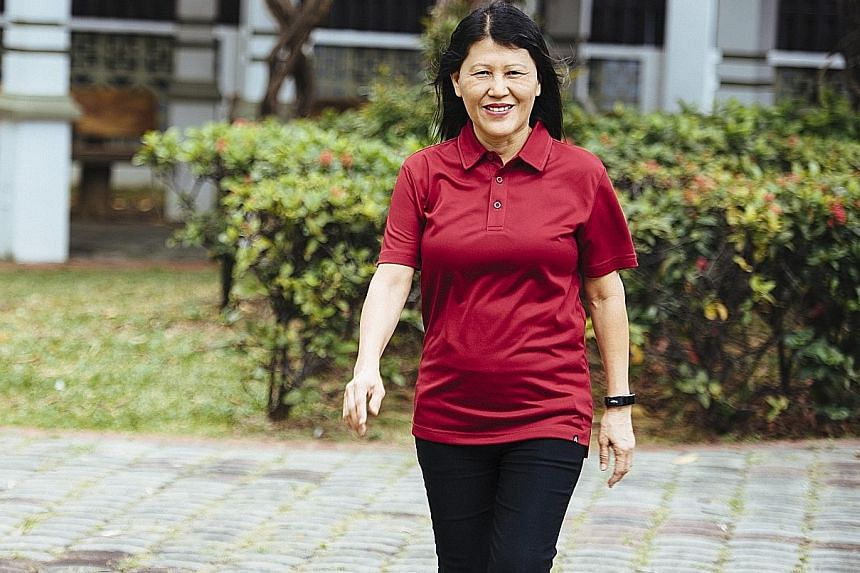 Ms Irene Lim does exercises such as push-ups and sit-ups before heading to work every day.