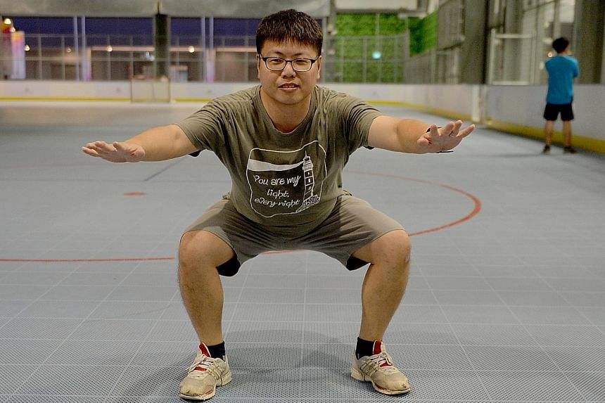 Mr Peter Pan doing a squat and turn exercise. The administrative assistant tries to be more active by walking to and from the MRT station at work, or walking to coffee shops farther away from his workplace.
