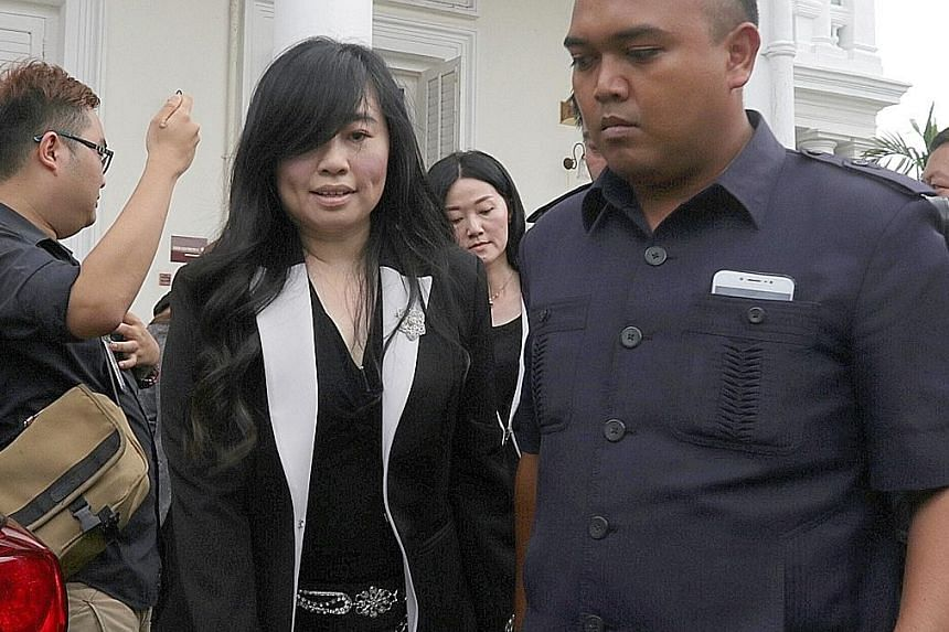 Left: Lim Guan Eng (in red tie) outside the High Court yesterday. Above: Businesswoman Phang Li Koon is charged with abetting Lim in obtaining a bungalow at below market price.