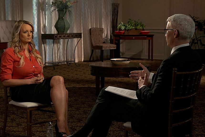 Porn actress Stormy Daniels with Mr Anderson Cooper of CBS' 60 Minutes. She told 60 Minutes she and Mr Trump had had sexual relations only once, but she had seen him on other occasions and he had kept in touch with her.