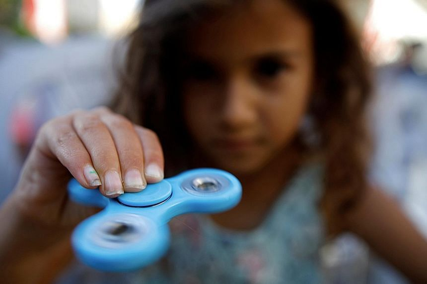 The battery cases in toys like fidget spinners must be secure so that young children cannot open them and remove the batteries, advises Spring Singapore.