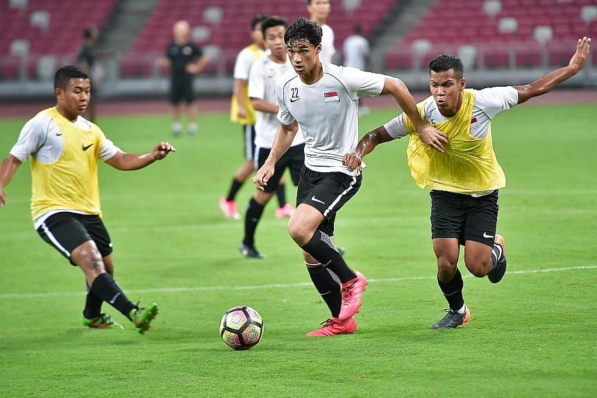 Ikhsan Fandi (centre) in action during training at the National Stadium. The 18-year-old forward was an unused substitute in last Friday's 3-2 friendly win against the Maldives but is likely to feature against Chinese Taipei today.