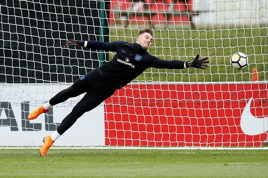 Stoke's Jack Butland feels that England manager Gareth Southgate's goalkeeper trial in friendly matches is creating a situation in which the four goalkeepers in the squad are driving one another on.