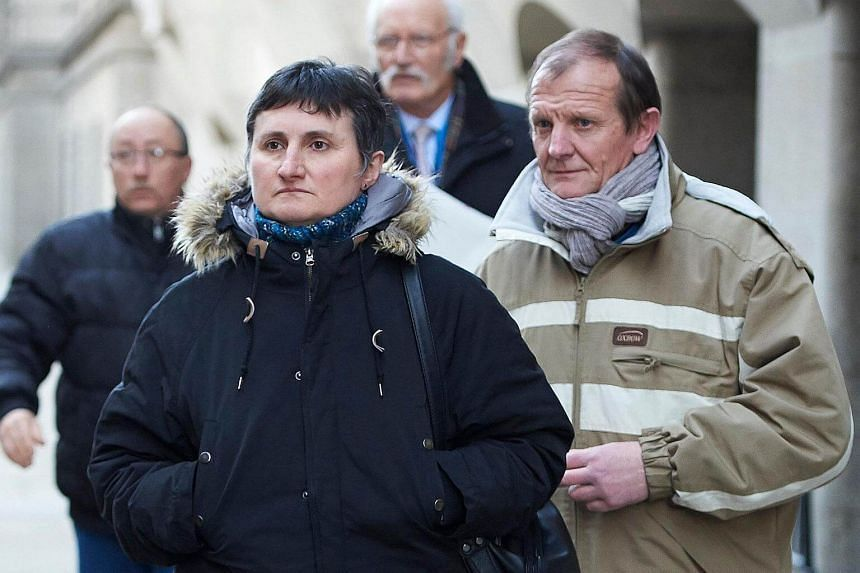 The parents of murdered French au-pair Sophie Lionnet, Catherine Devallonne (left) and Patrick Lionnet, leaving London's Central Criminal Court on March 19, after the opening of the trial of the couple accused of their daughter's murder.